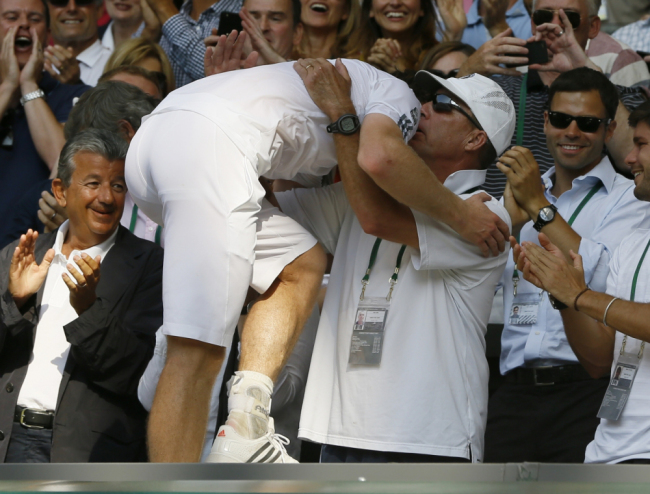 Andy Murray of Britain embraces his coach Ivan Lendl after defeating Novak Djokovic of Serbia